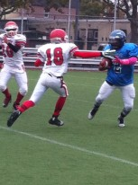 Sophomore Quarterback Johnny Watson eludes JFK defenders for nice gain in Canarsie's 14-6 win Saturday at home.