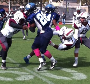 Canarsie tailback Palyte Stubbs sheds tackle for positive yardage.
