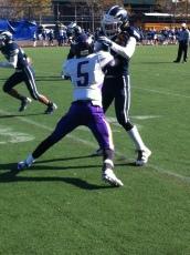 Vikings defender jams Engineer receiver at line.