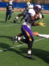 South Shore running back breaks away from Brooklyn Tech's defense.