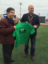 New York City Council Member Vincent Gentile flips the coin at today's match.